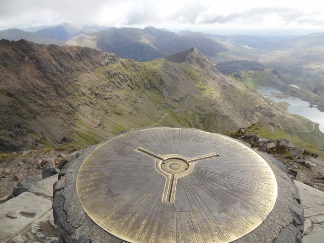 The view from the top of Mount Snowdon's trig point. It's trig point is embellished compared with standard trig points and includes this brass points of interest locator!