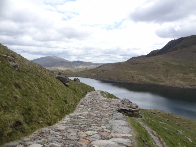 The Llyn Llydaw reservoir comes into view. Rather bizarrely I'm finding the descent quite hard work. In some ways it is harder than the climb and is certainly playing havoc with my knees and feet. The rocky paths don't seem to help in this regard.