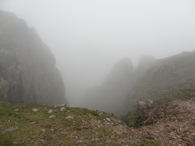 To the North are many big drops like this one. Subconsciously I know I need to descend via Foxes Tarn, but I incorrectly believe that I can take any route down....