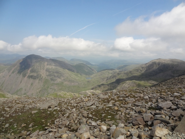 The view to the Northwest is excellent as I head downwards. In the far distance one can see Great Gable on the left and Styhead Tarn. I need to get to that Tarn via the 'Corridor Route'. Then from there I would head on upwards to Sprinkling Tarn - my camp spot for today.